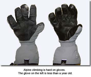 Alpine climbing gloves with heavy wear and tear
