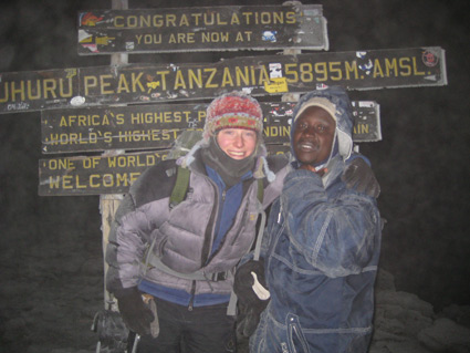 Here I am with Godfrey at the summit of Africa.